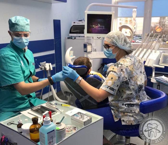 лізуть очні зуби фото ЛюміДент