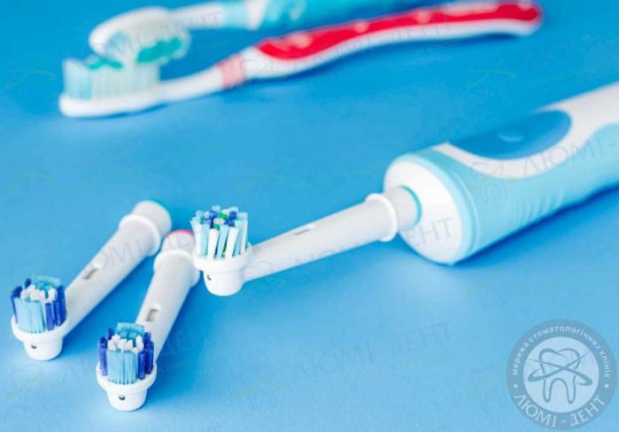 електрична зубна щітка фото ЛюміДент